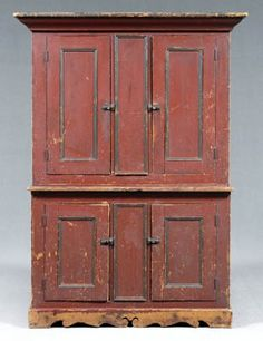 Ohio step back cupboard, pine throughout with probably original paint decoration, deep red with green painted moldings, sides and shelf fronts with traces of grain painting, upper section with two doors opening to three fixed shelves, lower section with two doors opening to fixed shelf and pale green painted interior, base deeply scalloped on front and sides, probably Ohio, 19th century, 75 x 48-1/2 x 19-1/4 in. Brunk Auction