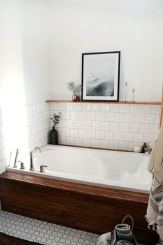 Lovely bathroom (I like the idea of tile up to natural shelf/ledge then white wall or shiplap above to ceiling)