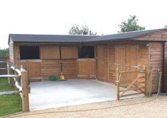 L Shape stable block with stable, corner box, tack room and hay barn with 2.1m wide barn doors. Black Onduline roof with galvanised ridge.