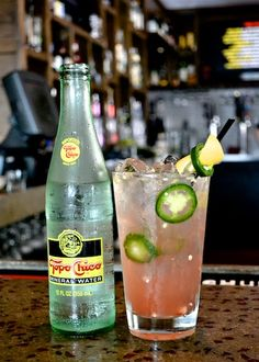 """""""Pink in the Muddle: Deep Eddy Ruby Red Vodka, St. Germain Elderflower, muddled jalapeno, lemon juice and Topo Chico"""" For Austin Fusion Magazine by Kristin Hong"""