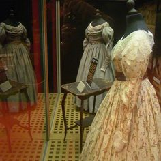 Les Miserables costumes. Green garden dress in back of image.