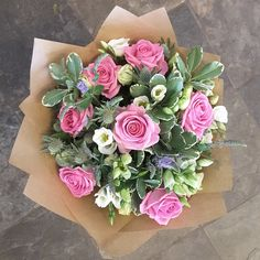 Handtie bouquet of pink Roses, white lisianthus, lavender and thistles, creating a pastel bouquet. Pastel Bouquet, Thistles, Pink Roses, Bouquets, Lavender, Floral Wreath, Wreaths, Seasons, Flowers