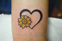 sunflower & heart wrist tattoo