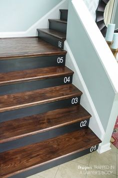 This DIY Staircase Renovation went from carpeting to wood risers and was completed in 1 weekend!