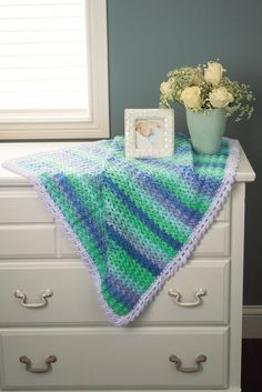 Prism Colors Blanket - Rain Shower & Lavender - Fascinating stripes form as you work this easy shell pattern. Kit includes Prism and Baby's Best yarns.