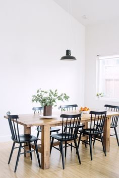 Simple, solid wood table paired with classic chairs (bentwood maybe?) for kitchen