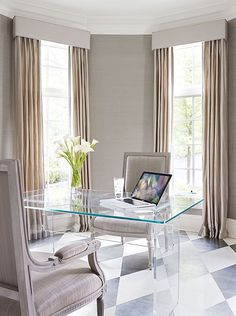 A Lucite desk provides transparency and allows attention to be focused on the silver-leaf harlequin pattern on the floor ~ Traditional Home Sept 2012