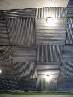 Unique look. Corrugated metal ceiling in bedroom.