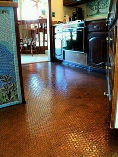 Penny floor - 275-325 pennies per square foot.  Thin set, then one coat of grout before covering with clear epoxy