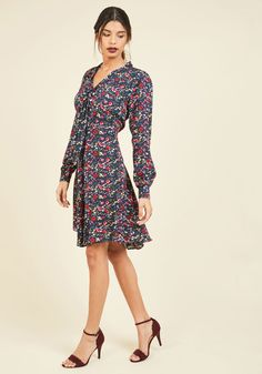 Giddy Committee Long Sleeve Dress. Sure, this navy blue dress dress means business, but with colorful wildflowers dancing about, it also means excitement and fun! #blue #modcloth