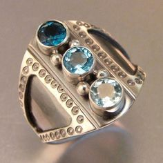 Melody Armstrong: Sheek Ring , 2012. sterling silver, aquamarine, swiss and london blue topaz