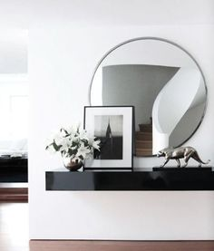 RALPH LAUREN HOME DESIGN NEW YORK ROUND MIRROR INTERIOR DESIGN BLOG ELLE DECOR, http://www.elledecor.com/image/tid/5842?page=4:
