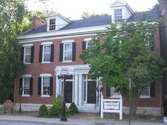 The Hart home was built as a duplex in basic Federal style with double chimneys on the gable ends. Early northern Greek Revival embellishments can be noted particularly around the twin entrances and the interior woodwork. The house is only one of two surviving residences along Belle Street, which, after the railroad was built, transformed the area into commercial/ Industrial use.