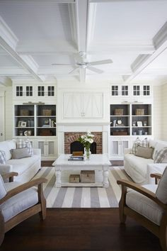 Love the coffered ceiling and built ins. Especially the idea of concealing the wall-mounted TV with doors.
