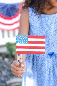 These patriotic of July party ideas will make your bash one for the books. Check out our games, food, decorations, favors and more. Popsicle Stick Crafts, Popsicle Sticks, Craft Stick Crafts, Craft Ideas, Craft Sticks, Jar Crafts, 4th July Crafts, Patriotic Crafts, Fourth Of July Crafts For Kids