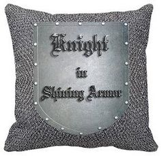 "Find a fabric that looks like ""chainmail"" and make throw pillows; add red iron-on knight insignia for color pop"