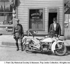 Officers with dog standing on motorcycle :: Park City Historical Society & Museum