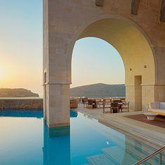 A hotel pool worth flying to: Blue Palace, a Luxury Collection Resort & Spa. Elounda, Crete, Greece. Coastalliving.com