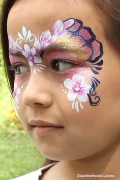 Fairy face painting. One stroke flowers and butterfly wings.