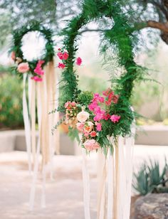 Floral wreaths make the perfect ceremony backdrop. DIY instructions included!