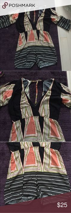 Adorable romper A low v neck front romper short sleeves with open back- bought off an Instagram page & didn't read the return policy that said all sales are final. Brand new never worn!! instagram  Other