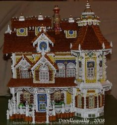 The name of artist is written at the bottom, on the right- 3D quilled architecture(Searched by Châu Khang)