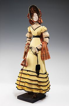 """1820 Doll""  House of Patou  (French, founded 1919)  Designer: Jean Patou (French, 1887–1936) Designer: Luzie (French) Date: 1949 Culture: French Medium: metal, plaster, hair, silk Dimensions: 32 x 13 3/4 in. (81.3 x 34.9 cm) Credit Line: Brooklyn Museum Costume Collection at The Metropolitan Museum of Art, Gift of the Brooklyn Museum, 2009; Gift of Syndicat de la Couture de Paris, 1949"