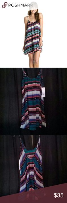 Brand new with tags Roxy Sweet Vida dress Brand new with tags Roxy Sweet Vida dress size Small. Gorgeous multi colors tribal style print. Dips low in the back. Roxy Dresses Mini