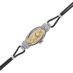 Art Deco Platinum, Diamond, Onyx and Emerald Wristwatch  C. 1920, cord strap
