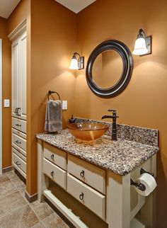 Burnt orange paint against the granite... This is what I want my bathroom to look like