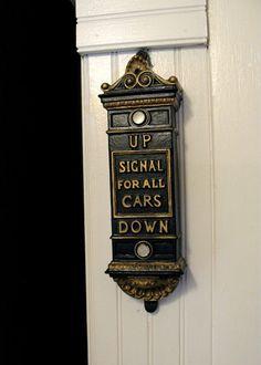 I covet this antique elevator sign.