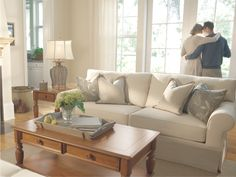 Freshen up your space with a classic wood coffee table and rolled arm sofa.