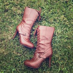 Brown Boots In mint condition. Worn once but look like new. Have a hidden platform. Easy to walk in. Zip on the side. Faux leather. Shoes Lace Up Boots