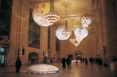 "Murakami's three inflatable sculptures—two giant ""eyeballs"" and a cartoon character named Oval—were suspended from the ceiling, while two additional floor sculptures echoed the motifs of the ceiling sculptures."