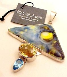 Fine Sterling Silver Charles Albert Pendant. Blue and Yellow Art Glass, Peridot, Topaz, mounted in .950 Fine Sterling Silver. High quality, one-of-a-kind Gemstone Jewelry Piece.