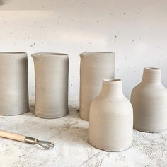 s t u d i o working on a wonderful collaboration - jugs/vases (and some bottles i just made for fun) . . #annemiekebootsceramics #ceramics #keramiek #handthrown #pottery #tableware #studio #studiolife #slowdesign #collaboration #connection #slowliving #theartofslowliving