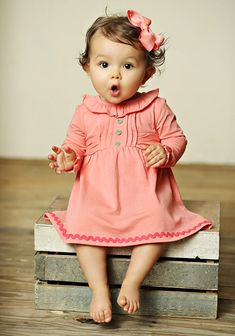 This baby looks just like Love. Guess that means we need this dress!