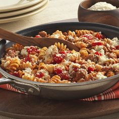 A one pan pasta recipe combines Italian sausage, Hunt's Tomatoes and rotini, with ricotta and Kraft Parmesan swirled in at the end