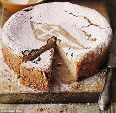 Tarta de Santiago, literally meaning cake of St. James, is an almond cake or pie from Galicia with origin in the Middle Ages.  The top of the pie is decorated with powdered sugar, masked by an imprint of the Cross of Saint James (cruz de Santiago) which gives the pastry its name..