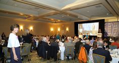 """President Alicia Lenahan surveys a packed room at """"Jimmy Miller's Bracket Breakfast for Piedmont CASA"""" on March 14, 2016. Image by Jennifer Byrne Photography."""