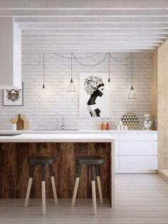 La utilización de materiales como la madera o Silestone y colores suaves proporciona calidez y amplitud a la cocina. Las barras no sólo sirven como apoyo a la encimera o como mesa para comer o desayunar sino que también permiten integrar placas modulares en la misma, añadiendo una tercera función.