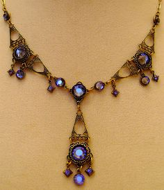 Shown in Tanzanite.  Matching Earrings  http://olivousretrojewelry.storenvy.com/products/192248-lacework  Handmade and designed from Swarovski crystal and solid brass findings with natural brass patina. If reasonably cared for these pieces can last for many years and brighten up with just th...