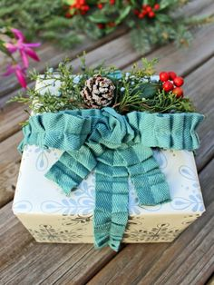 Easy Fabric Gift Wrap Ideas (http://blog.hgtv.com/design/2013/12/19/easy-fabric-gift-wrap-ideas/?soc=pinterest)