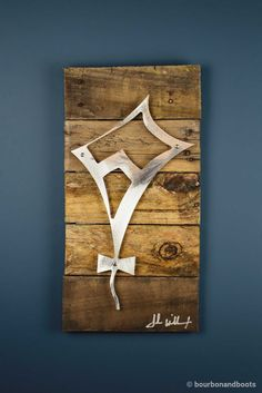 A perfect gift for the Theta Sorority Sister in your life, this stunning piece of art is the perfect blend of Iconic Metal married to reclaimed pieces of barn wood, resulting in rustic yet elegant art