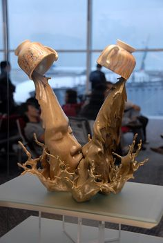Okay, but you can't see this and not be captivated, right? Isn't this what a kiss is? One fleeting moment, so difficult to immortalize? Warm & delicious, like hot chocolate on cold winter morning... I think I love this sculpture. ceramic sculptures Johnson Tsang