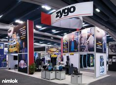Zygo Exhibit | Size: 20x40 | This custom modular exhibit features product displays, multimedia kiosks, semi-private meeting and product demo spaces and bold graphics to engage and inform visitors of your branded message. Finally, an open floor plan allows for reconfiguration from show to show. | More #islandexhibits here - http://xtremeexhibits.nimlok.com/custom-trade-show-exhibits/