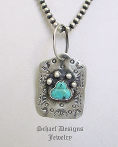Schaef Designs Fred Harvey style turquoise paw & sterling silver dog tag pendant
