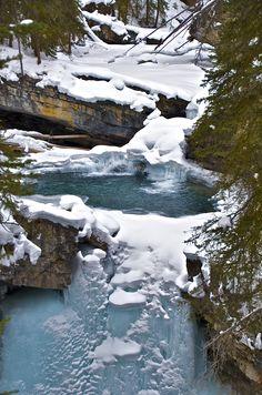Snow, water and Ice, near Banff. Alberta, Canada