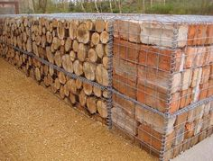 brick and log filled gabion wall http://www.gabion1.com