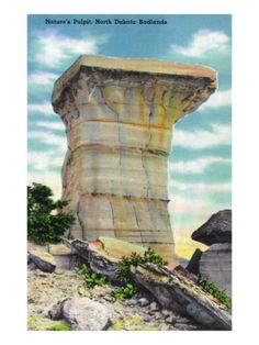 In the Badlands there are lots of different rock sculptures. There are also some different colors as well as lays from million years ago. This particular formation is Natures pulpit, North Dakota Badlands